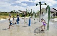 Kids play at the splash park